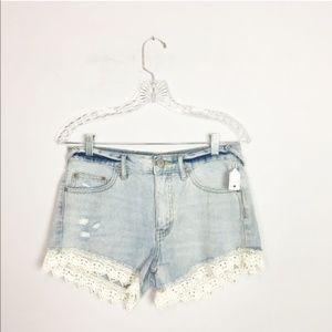 Free People hi rise denim shorts stone lace trim
